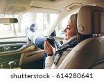 woman traveler sitting in a car ... | Shutterstock . vector #614280641
