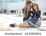 young mother with child outside ... | Shutterstock . vector #614283341