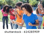 group of cheering people using... | Shutterstock . vector #614285909