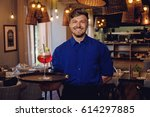 waiter with alcoholic cocktail... | Shutterstock . vector #614297885