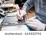 close up hands of a service... | Shutterstock . vector #614333741
