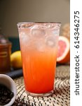 Small photo of cool grapefruit ade with glass on table