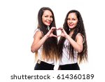 Two Woman Twins Showing Heart...
