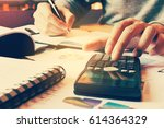 calculator with woman hand... | Shutterstock . vector #614364329