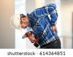 worker getting back pain inside ... | Shutterstock . vector #614364851