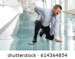 Senior Businessman Suffering...