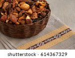 dried fruits in a wicker dish.... | Shutterstock . vector #614367329