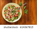 fresh spinach salad with tuna ... | Shutterstock . vector #614367815
