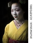 Small photo of KYOTO, JAPAN - CIRCA JULY 2014 - A Geisha's job is to please her guests. In the modern day her duties have had to accomodate requests of posing for photos to keep up with guests social media wants.