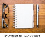 blank open memory book with pen ... | Shutterstock . vector #614394095