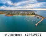 Beautiful aerial panorama of Mornington Peninsula coastline and Mornington Pier at sunset. Melbourne, Victoria, Australia