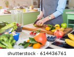 cropped image of female cook... | Shutterstock . vector #614436761