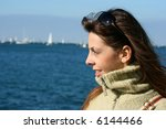young girl is looking regatta ... | Shutterstock . vector #6144466
