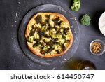 pizza with broccoli on dark... | Shutterstock . vector #614450747