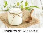 yogurt in glass bottles on... | Shutterstock . vector #614470541