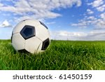 Football or soccer ball on a green lawn - outdoors - stock photo