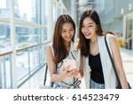 two young girls go shopping... | Shutterstock . vector #614523479