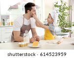 dad and son cooking at home   Shutterstock . vector #614523959