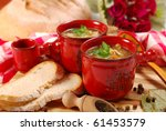 traditional polish tripe soup with vegetables in red ramekin - stock photo