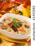 autumn mushroom soup with cream and vegetables in white bowl - stock photo