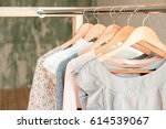 Stock photo female clothes on clothing rack pastel colors 614539067