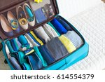 the order in the suitcase.... | Shutterstock . vector #614554379