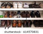 men shoes on shelves in a closet | Shutterstock . vector #614570831