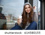 smiling relaxed young woman... | Shutterstock . vector #614580155