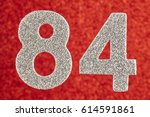 Small photo of Number eighty-four silver color over a red background. Anniversary. Horizontal