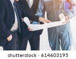engineers and business men in... | Shutterstock . vector #614603195