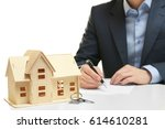 house model with key and man on ... | Shutterstock . vector #614610281