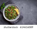 tabbouleh salad  plate  rustic... | Shutterstock . vector #614616089
