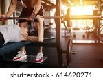 personal trainer helping woman... | Shutterstock . vector #614620271