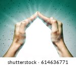 Small photo of Two hands protect your object from unfavorable factors.