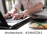 businesswoman working on laptop ... | Shutterstock . vector #614642261