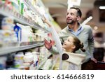 happy girl pointing at pack of...   Shutterstock . vector #614666819