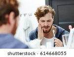 man with sensitive teeth... | Shutterstock . vector #614668055