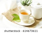 organic tea in white cup with... | Shutterstock . vector #614673611