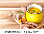 cup of turmeric tea with lemon ... | Shutterstock . vector #614674094