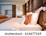 luxury hotel bedroom and... | Shutterstock . vector #614677169