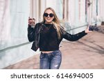young girl walking on the city... | Shutterstock . vector #614694005