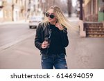 young girl walking on the city... | Shutterstock . vector #614694059