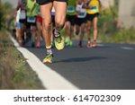 marathon running in the light...   Shutterstock . vector #614702309