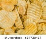 crinkle cut potato crisps or... | Shutterstock . vector #614720417