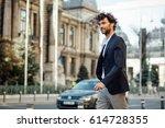 elegant and modern man walking...   Shutterstock . vector #614728355