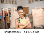 portrait of a young african... | Shutterstock . vector #614735435
