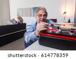 an elderly man carefully... | Shutterstock . vector #614778359
