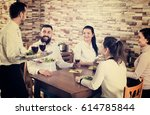 cheerful male waiter bringing... | Shutterstock . vector #614785844