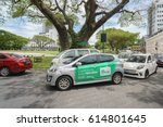 """Small photo of Kuching Sarawak Malaysia - Apr 3, 2017 : Car with Grab advertisement words in Malay translated as """"Hi Kuching lets try for free today"""". Grab offers ride-hailing through its app in Southeast Asia."""