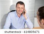 man on the phone receiving a... | Shutterstock . vector #614805671